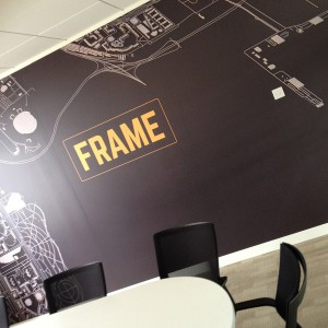 Frame Recruitment Interior Rebrand with Logo on wallpaper