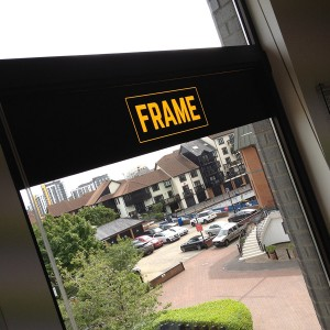 Frame Recruitment Interior Rebrand with Logo on glass window