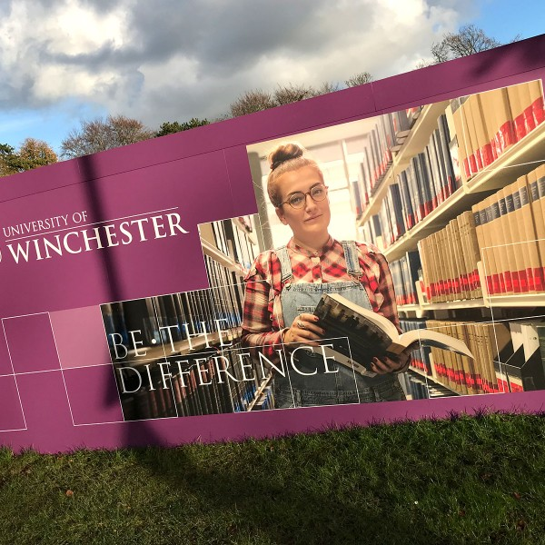 Building site hoarding graphics at University of Winchester